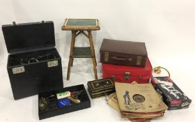 Assorted suitcases and small green tiled square two-tier occasional table and a Singer sewing