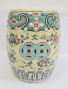 Chinese porcelain garden seat, barrel-shaped, decorated with peony border, floral sprays to a yellow
