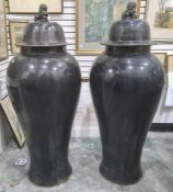 Pair of large Oriental floor standing porcelain covered meiping vases, each with dog of fo finial to