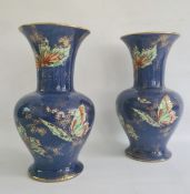 Pair of Rialto ware blue lustre vases decorated with butterflies (one repaired) (2)