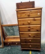 20th century narrow pine chest of six drawers, a dressing table mirrorand a pine wall-hanging shelf