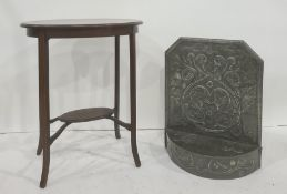 Pewter firescreenwith foliate decoration to the rectangular back, with canted top corners, demi-