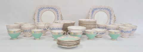 Foley china part tea service, pink ground decorated with blue flowers and a set of six Foley china