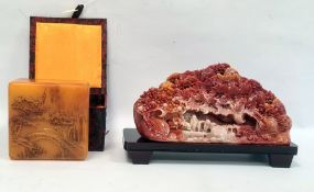 Simulated soapstone resin carving of wooded scene and the hardwood stand, 23cm side and a variegated