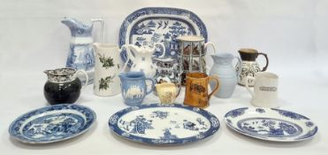 'Old Willow' pattern oval dish, a blue and white meat plate, a blue and white jug, other Victorian