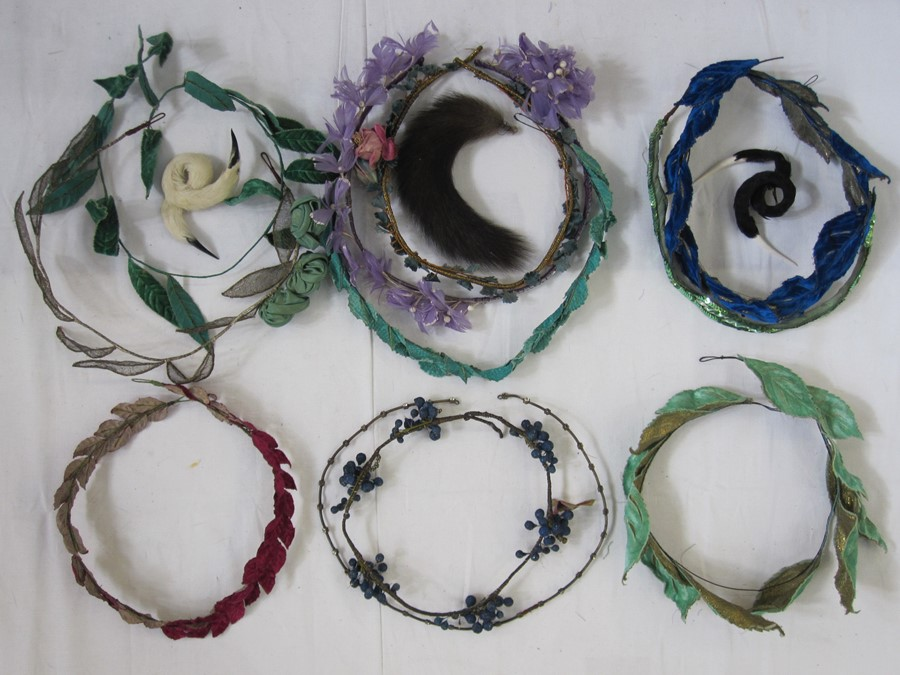 Collection of 1920's headdresses to include velvet decoration, sequins, faux-flowers, feathers,