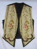 Mid 19th century front panels of a gentleman's waistcoat, machine embroidered, the black satin
