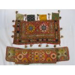 Indian embroidered piecewith mirror detail, shell and tassel fringes and another Eastern