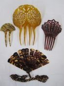 Three carved tortoiseshell and faux-tortoiseshell hair combs and a tortoiseshell folding brise