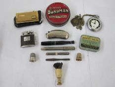 1920's/30's cigarette holder,a silver thimble,Ingersoll white metal pocket watch, cigarette