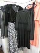 Vintage viscose black dresswith fringe detail to the waistline, to the hem and to the sleeves, with