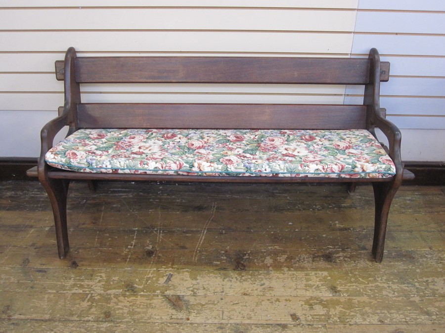 Dark wood bench with floral cushion and similar oval slatted coffee/occasional table, on straight