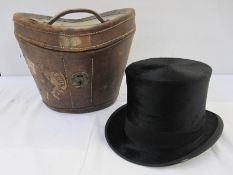Gieves Limited silk top hat (small tear to the fabric in the rim) within original fitted leather hat