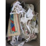 Eastern-style embroidery on canvas, table runnerand a large quantity of embroidery samples,