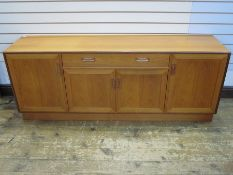 Mid 20th century G-Plan teak sideboardwith curved bar handles, single drawer above cupboard,