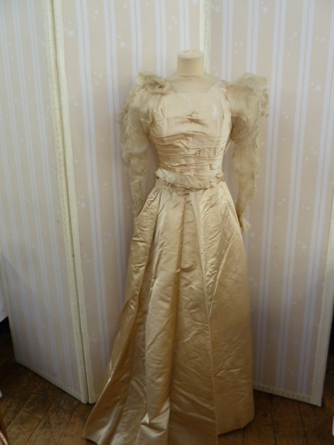 Victorian  ivory satin wedding dress with pleated bodice, full skirt, chiffon ruched sleeves -