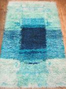 Two 1970's turquoise and blue shag pile rugs , both 155 x 95 cms Condition Reportboth need a