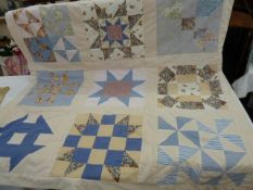 Modern patchwork quilt showing the various American quilt patterns, and modern patchwork hanging