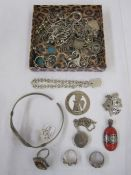 Silver rope-pattern chain, a silver locket, a silver and coral stone set pendant, various rings