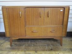 E Gomme Brandon range, G-plan sideboard, three cupboards and drawer below on tapering supports,