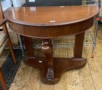 A reproduction demi-lune table, 91cm wide