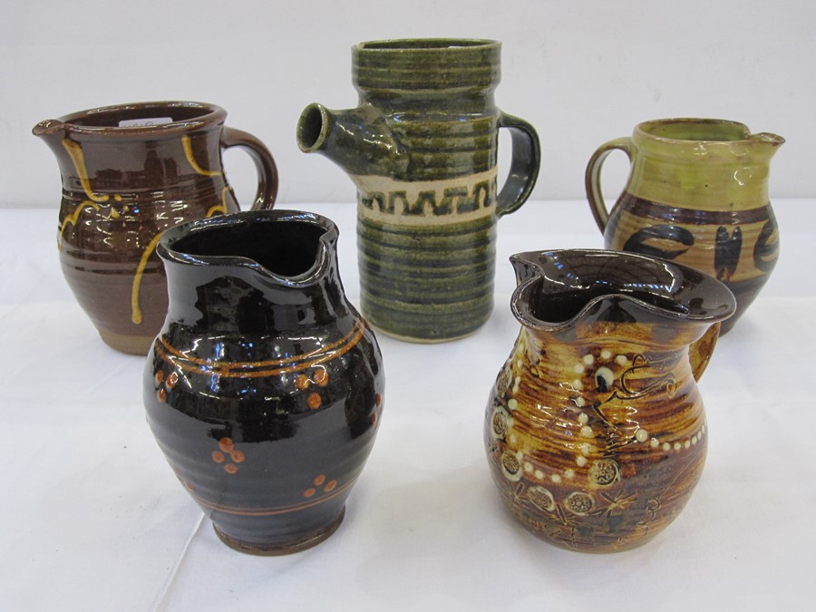 Five studio pottery jugs, one green glazed jug with studio pottery mark 'BP' to base, a Winchcombe