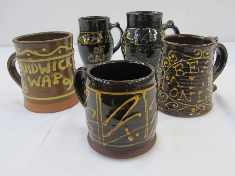 Five 20th century pottery tankards to include one inscribed 'Randwick Wap 1990', another marked '