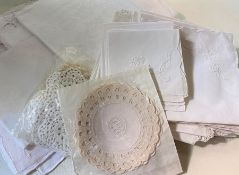 Assorted table linen to include damask napkins, embroidered tablecloths, etc (1 bag)