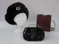 Birger Christensen mink beret, Anya Hindmarch black patent leather zipped make up bag and a small
