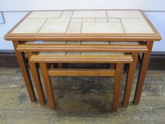 20th century nest of three tile-top tablesin beige, 64cm wide