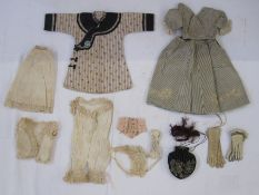 Victorian doll's clothes to include two pairs of gloves, a silk dress and top, undergarments, pair