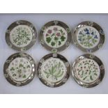 Set of six Wedgwood Arts & Crafts platesby Alfred Powell, each with silver lustre rims and floral