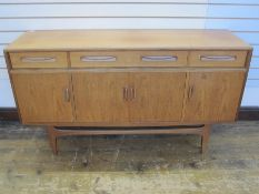 V B Wilkins G-Plan fresco sideboard, four drawers above cupboards on straight supports, 150cm wide