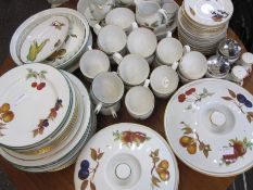 Quantity of Worcester 'Evesham' pattern part dinner and tea servicecomprising mugs, serving dishes,