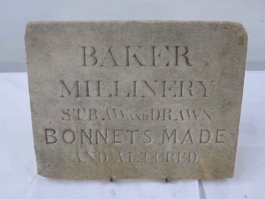 Stone advertising plaque 'Baker Millinery Straw and Drawn Bonnets Made and Altered', 25.5cm x