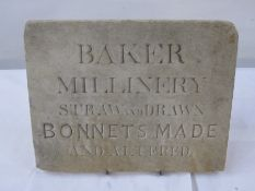 Stone advertising plaque'Baker Millinery Straw and Drawn Bonnets Made and Altered', 25.5cm x