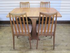 E Gomme for G-Plan set of four teak dining chairswith brown upholstered seats, label to