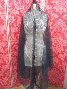 Large black lace on net, triangular-shaped shawl, a lace collar, a length of lace, possibly cut