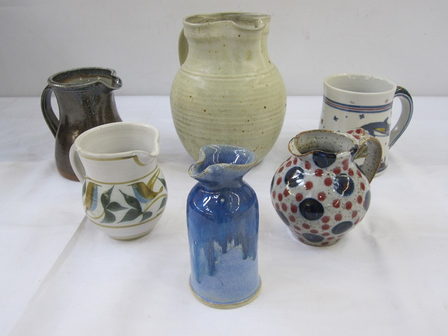 Quantity of studio potteryto include blue and red polka dot jug marked 'Goldsmiths' to base, studio