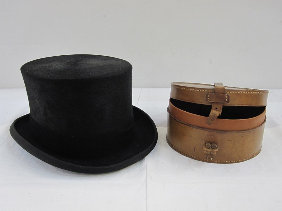 Black top hatmarked 7¼ or 59cm, 100% fine fur felt and a leather collar box(2)