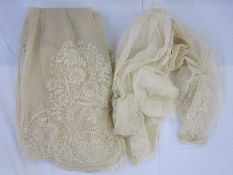 Net and lace skirt from a dress, late 19th century, one ruched sleeve and another short length of