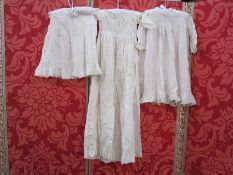 Two cotton and lace babygowns, a cotton sleeveless petticoat and a fine wool shawl marked 'Rob Roy'
