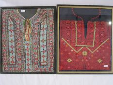 Embroidered Palestinian dress front, framed, a Bedouin dress front, framed, a tribal dress front