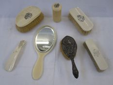 Ivory dressing table setto include mirror, clothes brush, shoe horn and two hair brushes bearing