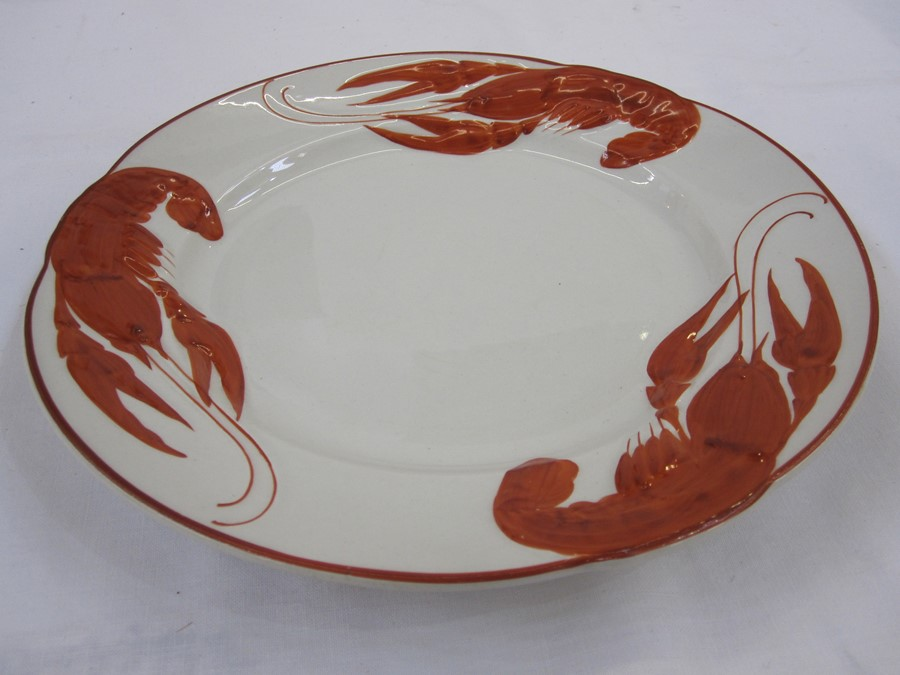 Set of 12 French lobster decorated plates, marked to base 'Rorstrand', in red, decorated with
