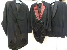 Three vintage dinner suits, one tail coat , one morning suit jacket and various trousers and a