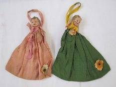 1940's lavender/mothball cloth poucheswith plastic doll heads (one broken)