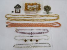 String of graduated amber-coloured beads, coral beads, crystal and similar vintage bead necklaces