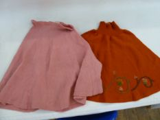 early 1970's pink knitted 'skater' skirt, labelled CAZGIN, and an orange knitted mini skirt , with