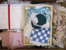 Pair of cotton sheets, assorted table linen and two vintage pinafores, one printed with the head